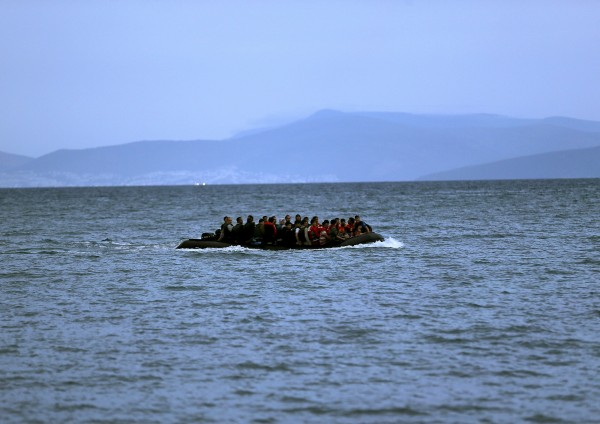A dinghy overcrowded with Afghan immigrants is seen off the coast of the Greek island of Kos whille crossing a part of the Aegean Sea between Turkey and Greece